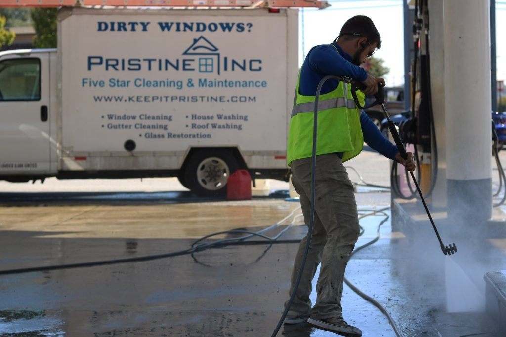 COMMERICAL CLEANING | WASHING CONCRETE PAD AT GAS STATION